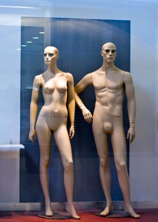 Female and male figure in the window naked.
