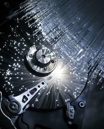 Computer hard disc, illuminated optical fiber.  Stock Photo - 5364195