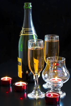 Champagne, red candles in a dark background. Stock Photo - 6012198