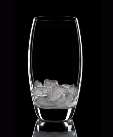 Glass with ice, black background. photo