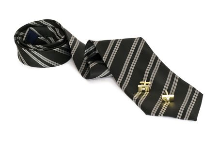 cuff: Black striped tie, cuff buttons, a white background isolated.
