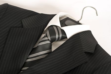 Striped black suit and tie. photo
