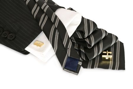Black striped tie, cuff buttons, a white background isolated. Stock Photo - 6251765
