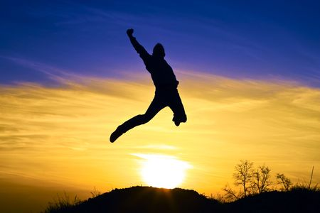 Young athletic man jumps in the sunset. Stock Photo - 6746552