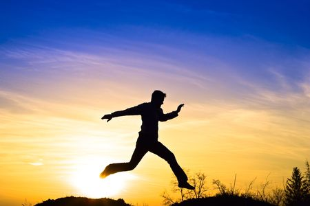 Man jumping in the sunset. Stock Photo - 6876212
