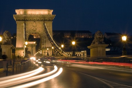 Budapest is a beautiful bridge, the cars are going. photo