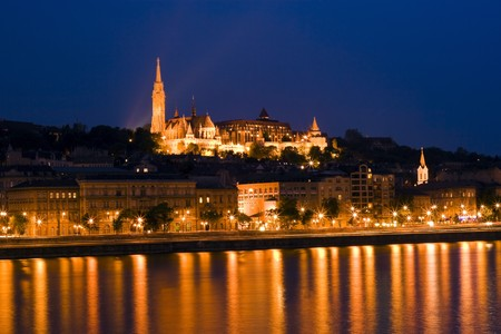 Beautiful Palace in Budapest, is reflected in the River. photo