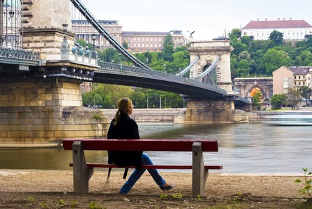 Girl looking at the city along the Danube photo