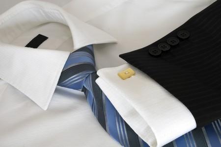 suit  cuff: White male shirt, blue tie.