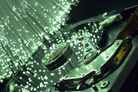 Computer hard drives, optical glass illuminated. photo
