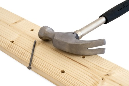 Hammer and nails to the wooden board. photo