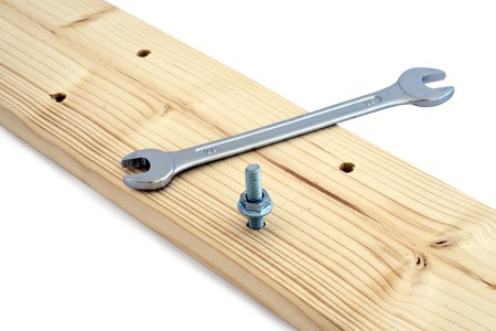 Screw the wooden boards wrenches. Stock Photo - 8107474