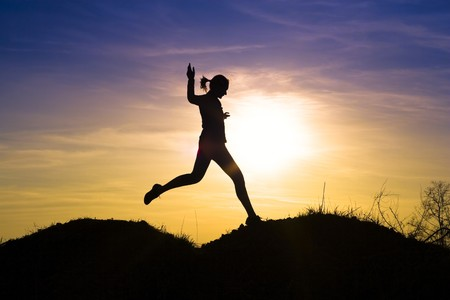 Decorative young girl running outdoors.