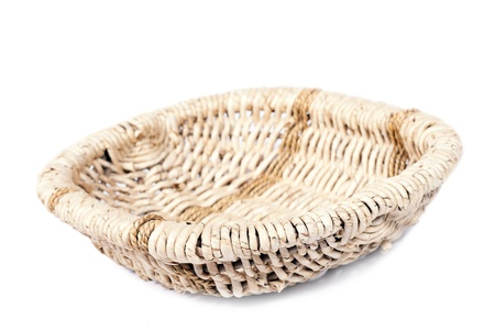 Wicker basket is hand-prepared, isolated on a white background.  photo