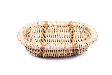 Round wicker basket with a white background isolated. photo