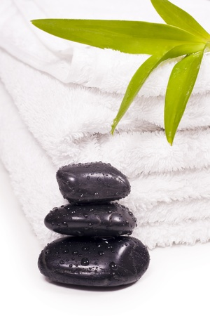 Black pebbles drops of water and towels. Stock Photo - 8951596
