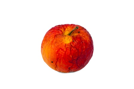 Old red rotten apple, isolated on a white background.