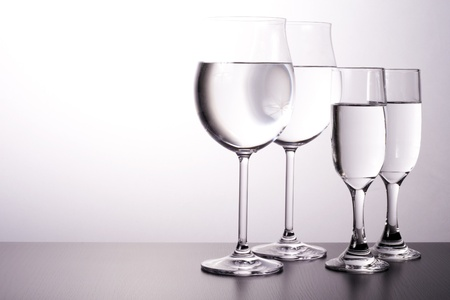 table glass: Glass cups, and lit up in style.  Stock Photo
