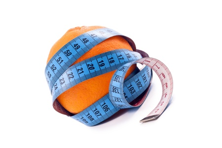 Orange and measuring tape isolated on a white background. photo