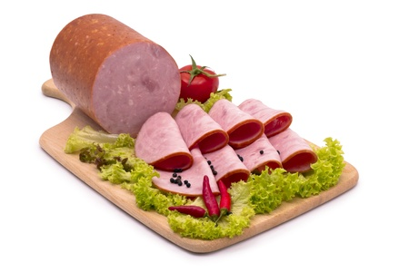 Delicious sausages, vegetables, decorated with a white background isolated.