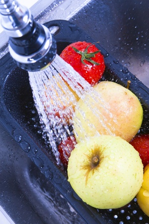 Kitchen faucet, tasty fruits and vegetables, washed down.