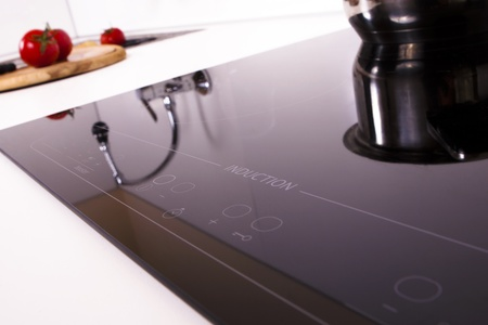 stone worktop: Induction cooker cook in the kitchen.