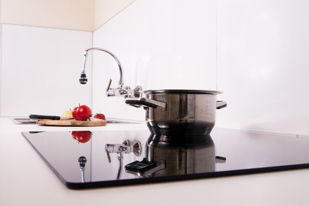 stone worktop: Modern kitchen; cook the induction cooker.