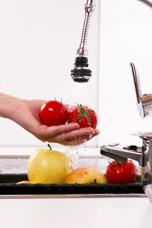 Kitchen faucet, wash your fruits and vegetables. Stock Photo
