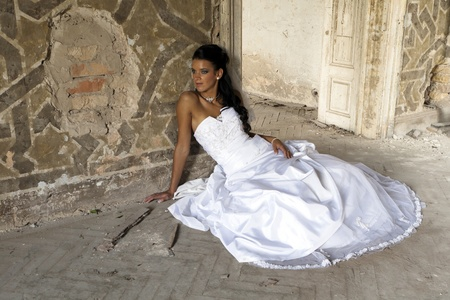Beautiful young bride in white dress. photo