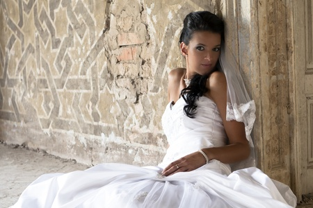 Beautiful young bride in white dress.