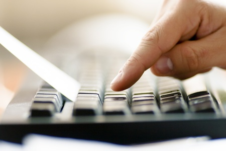 Man hands on the keyboard to use. photo