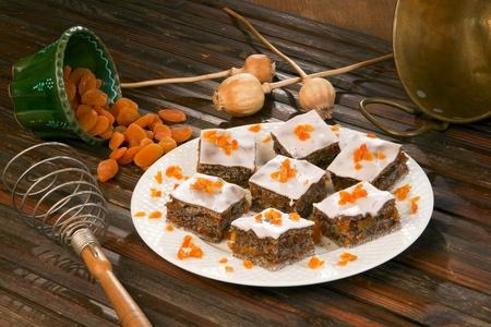 Poppy seed, orange cake, nicely served.