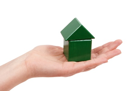 A womans hand green house in your hands. Stock Photo
