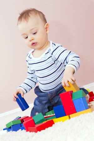 Baby boys building creative play dice. Stock Photo