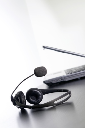 mobile headset: Computer and headset on the table, nothing else.
