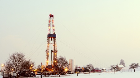 Oil rig in the field. Stock Photo