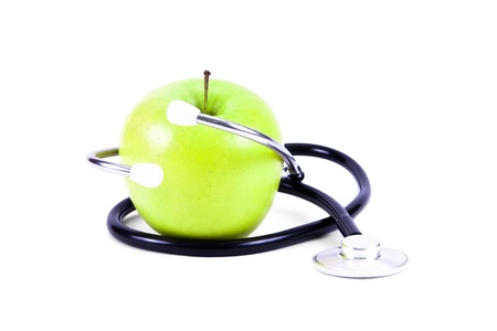 nutrition doctor: Green, ripe apple and stethoscope  Stock Photo