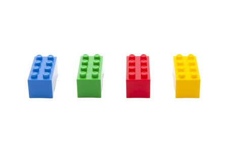 Four colorful construction toy next to each other photo