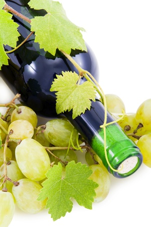 Bottle of wine and grapes and leaves  photo