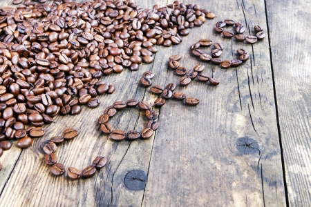 The word coffee beans laid out the wood table  photo
