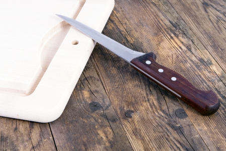 Knives and cutting boards for wood table  photo