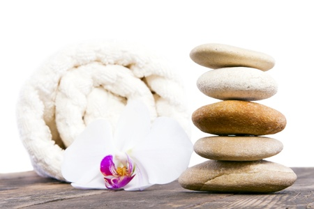 towels luxury: Stones towel and orchid beside him  Stock Photo