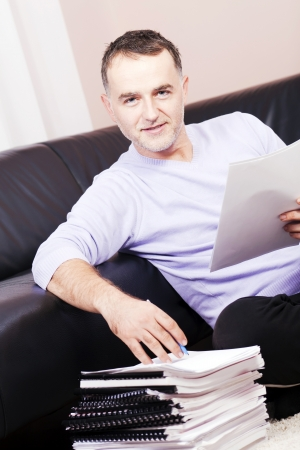 Successful man working at home Stock Photo - 16301321