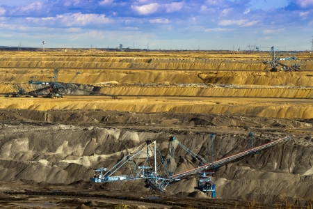 Opencast mine, working machines  photo