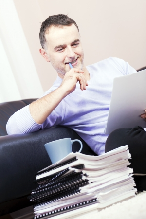 Successful businessman working at home  photo