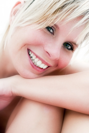 Portrait of beautiful blonde girl smiling  photo