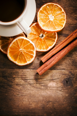 Tastefully presented with a cup of coffee, and orange slices  photo