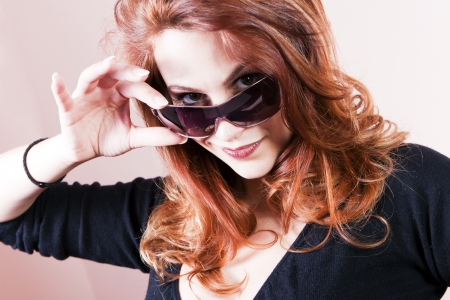 Beautiful young woman with sunglasses smiling  photo