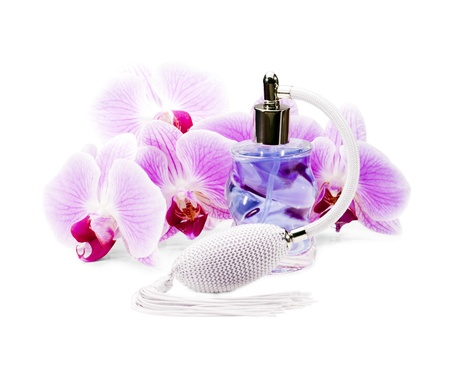 Perfume bottle surrounded by beautiful orchids