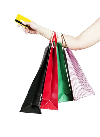 Credit cards and shopping bags holding the hand of a woman. photo